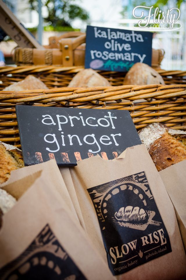 baskets and bags of breads and scones from slow rise bakery. Love the signs and the bags. Where do they get the bags? Bakers want to know.