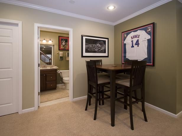 If you're going to have guests over or make your basement a social area, you'll need a table. Depending on what purpose you want to give your basement, it could be a couple of small side tables, a low coffee table, or a counter along a wall.