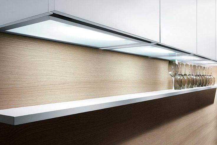 Perfectly light your shelf with LED under cabinet lighting from Schüller - Ideal when you're reaching for your wine glasses!