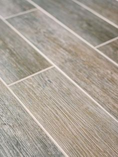 With wood flooring in high demand from both homeowners and builders alike, many tile manufacturers have started creating planks of porcelain which look and feel like true hardwoods, but with more durability. Available at lower cost than hardwoods, porcelain plank is often a more practical choice since it's waterproof, easy to clean and more resistant to scratches than wood.
