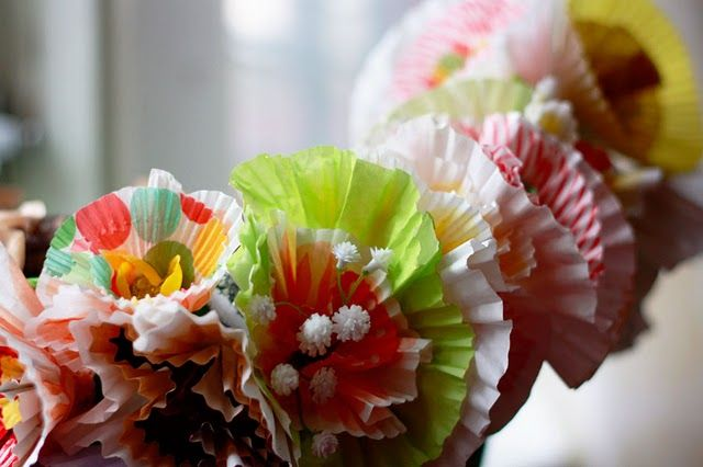 Cupcake liner flowers.  These would look great on aprons and chef hats for birthday party.