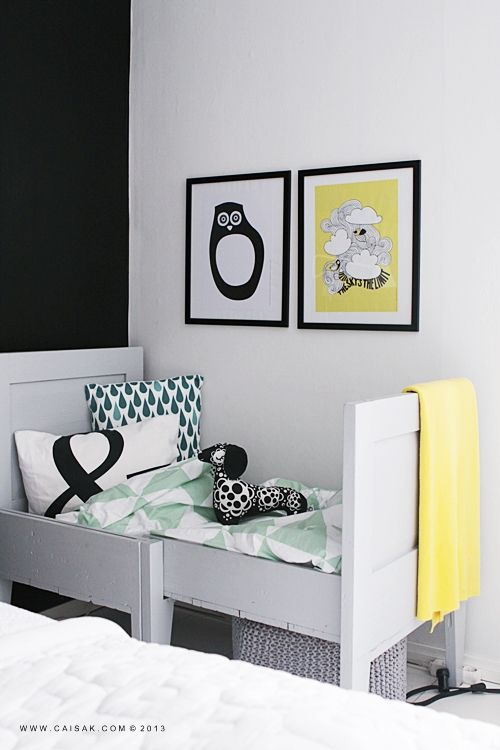 graphic pillows and posters + yellow accent- great bed.