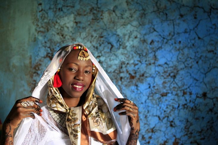 In Nubia, brides wear headscarfs, hide their faces behind sheer veils, and use additional white veils to cover their hair.