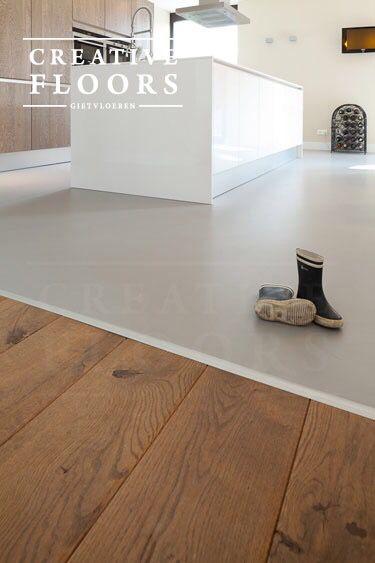 Gietvloer keuken met overgang hout naar gietvloer