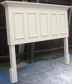 king size headboard made from an old door, doors, home decor, repurposing upcycling, King size door headboard made from and old door panels on the front side skirts crown molding supported shelf and legs added Finished in a satin Popcorn white
