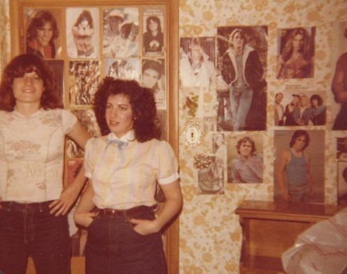 Teen girl's bedroom wall decorated with male hunk posters, 1980.
