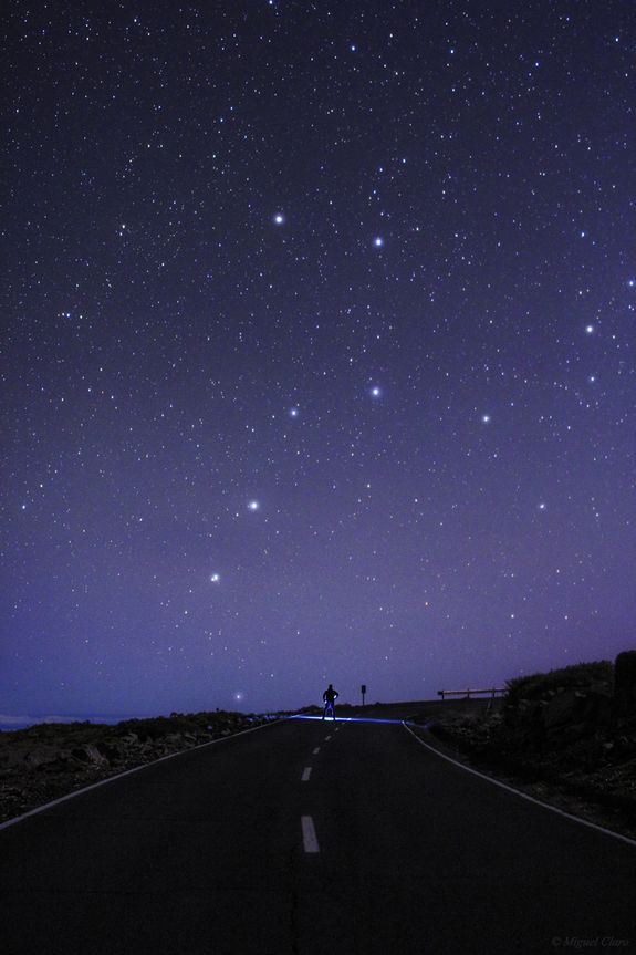 """""""A Road to Big Dipper"""";  photo by astrophotographer Miguel Claro of the famed Big Dipper star pattern, part of the iconic bear constellation Ursa Major, as it pours starlight over a stargazer on the La Palma road to Roque de Los Muchachos in Spain's Canary Islands."""