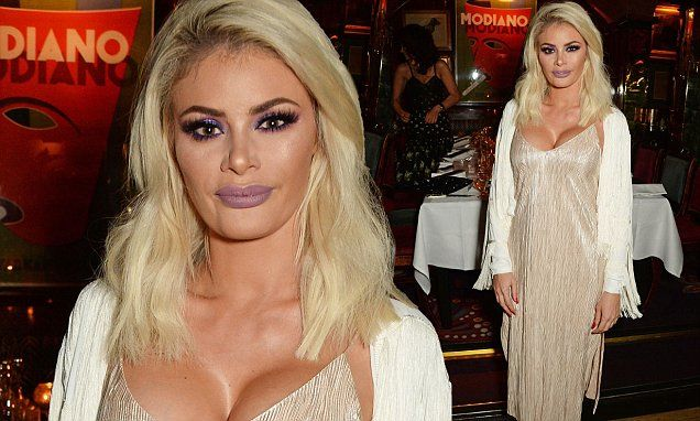 Chloe Sims comes close to spilling out of her glamorous silk gown