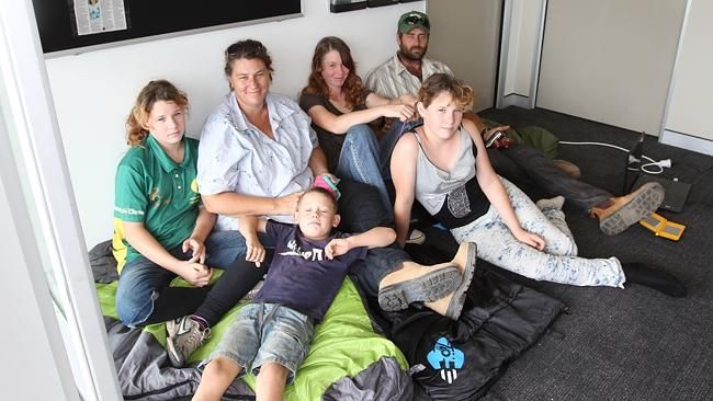 "A HOMELESS family has ""occupied'' the electorate office of Premier Annastacia Palaszczuk today.  Kylie Haeusler, her five children and partner Shane Taylor spread out sleeping bags on the floor and refused to leave the building in the Richlands Plaza until the Labor leader promised to help with their plight."