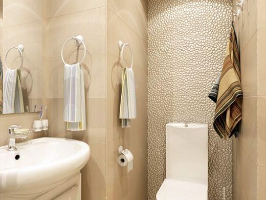 Ванная комната в данной квартире сочетает технологии и комфорт. При входе в ванную комнату внимание приковывает душевая кабина. Речь идет о веерообразной угловой душевой кабинке с парилкой с оздоравливающим эффектом и смесителем душа с цифровым термостатическим контролем. Из других важных элементов в ванной комнате есть, конечно же, умывальник и унитаз, а также современная стиральная машина, над которой установлена хромированная белая полка для полотенец.