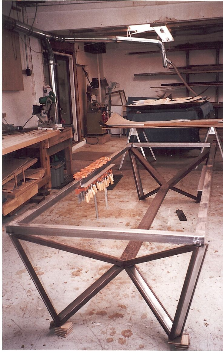 Welded table base made from steel