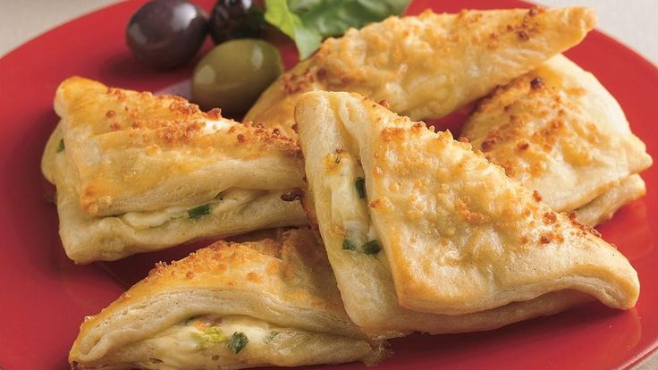 cheese crescent bites hold a warm, cheesy filling in a crowd-pleasing appetizer.