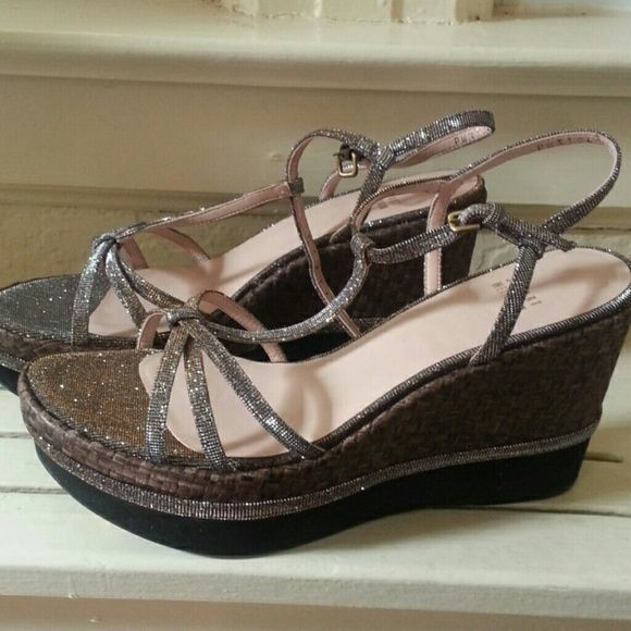 NEW Stuart Weitzman Velocity Metallic wedge 9.5 Gorgeous macrame rubber and silver hill the top of the shoe is gold and silver and this could be and everyday shoe we're wedding/ formal shoe.Price is fitm. Stuart Weitzman Shoes Wedges