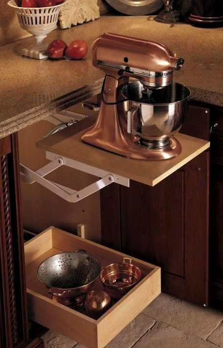 Pop-up cabinet so you can hide the mixer yet don't have to move it when you need it. Genius!