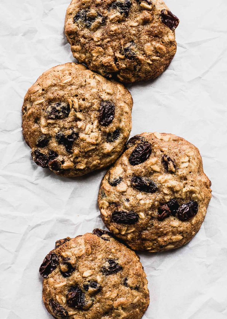 These Soft Olive Oil Oatmeal Raisin Cookies are moist, spiced, & incredibly delicious! Made w/ olive oil instead of butter, oats, almond flour, & honey.
