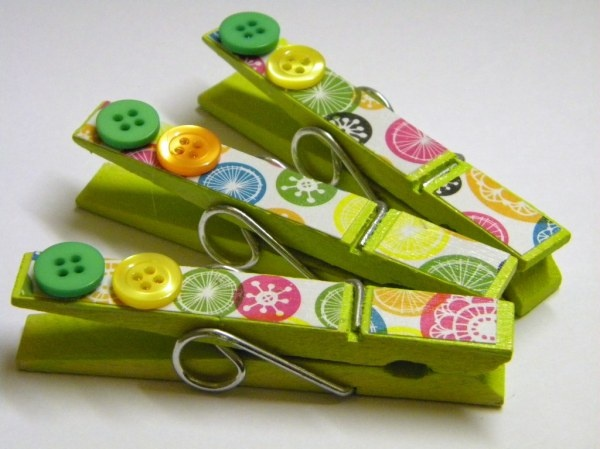 clothespins...You could even put a magnet on back to hang pictures on fridge....too cute!