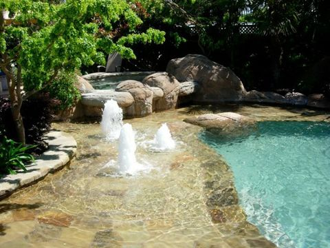 The kids (and big kids) will love this water feature in the shallow shelf next to the pool.  More garden/pool design here.