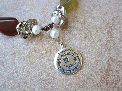 Jade Pearl amor necklace - Jade and Pearl love charm necklace with the word LOVE / Amor in many languages on this lovely piece of Charm Word jewelry
