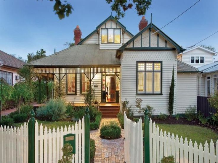 Corrugated iron edwardian house exterior with picket fence & hedging - House Facade photo 309875