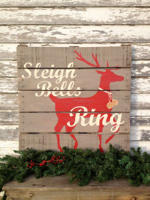 This would be cool to try -- Holiday Hand Painted Repurposed Pallet (by soulshineliving on Etsy)