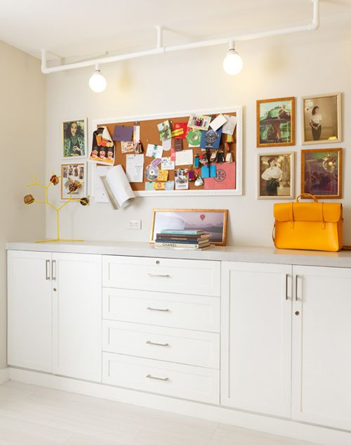 Tall, built in cabinets for storage doubles as a workstation (for art projects). Love the idea o having pin boards and track lighting to display work, ideas, etc.