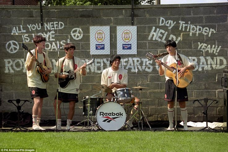 (Left-right) Liverpool stars Steve McManaman, Rob Jones, Stan Collymore and Jason McAteer mimic the Beatles as they unveil a new ecru away kit in 1996 at Melwood. Liverpool earned the nickname The Spice Boys during the 90s