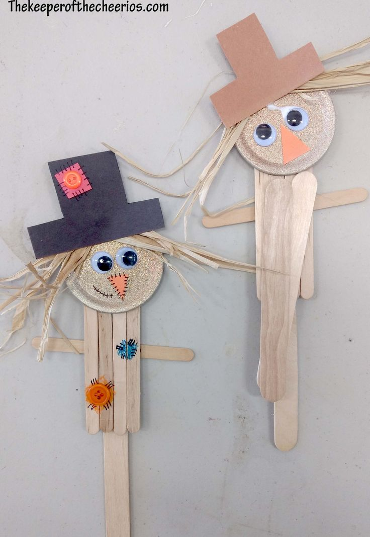 Scarecrow Popsicle Stick Craft Materials: small popsicle sticks jumbo popsicle stick wiggle eyes black and orange construction paper Raffia black sharpie crayons glue small mason jar lid gold paint or we used Glitter Blast spray buttons other misc embellishments Directions glue your popsicle sticks together (we used a small stick across the back for arms and then added the jumbo stick, this held everything together) paint your small mason jar lid and then glue it to the top of the popsicle…