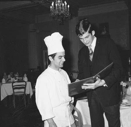 Robin Leser discussing the day's menu with second chef George Moustakas in 1969.