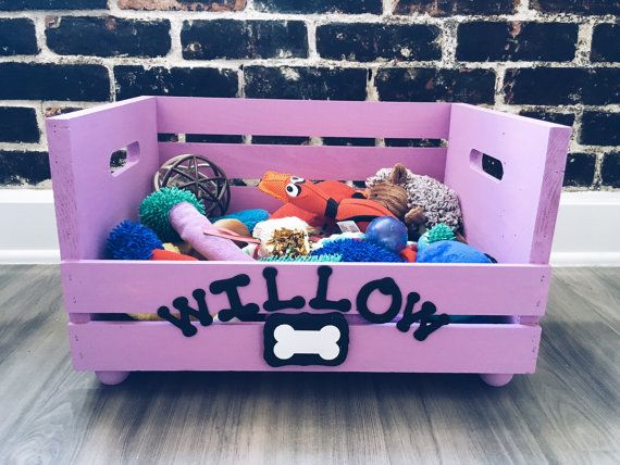 Keep all those ropes, balls, and chew toys in one handy place with this Rustic Dog Toy Box. This hand-crafted box is made from pine and given a chalk Lavender color for lasting durability. All boxes are customized with your pets name in hand finished lettering.  Toy box approx. size: 12 wide x 18 long and 8.5 high  <<This Lavender toy box is PERFECT for a female dog >>  IMPORTANT: Legs come separately and can be easily assembled with a little glue (wood or krazy glue)   Please add a note of…