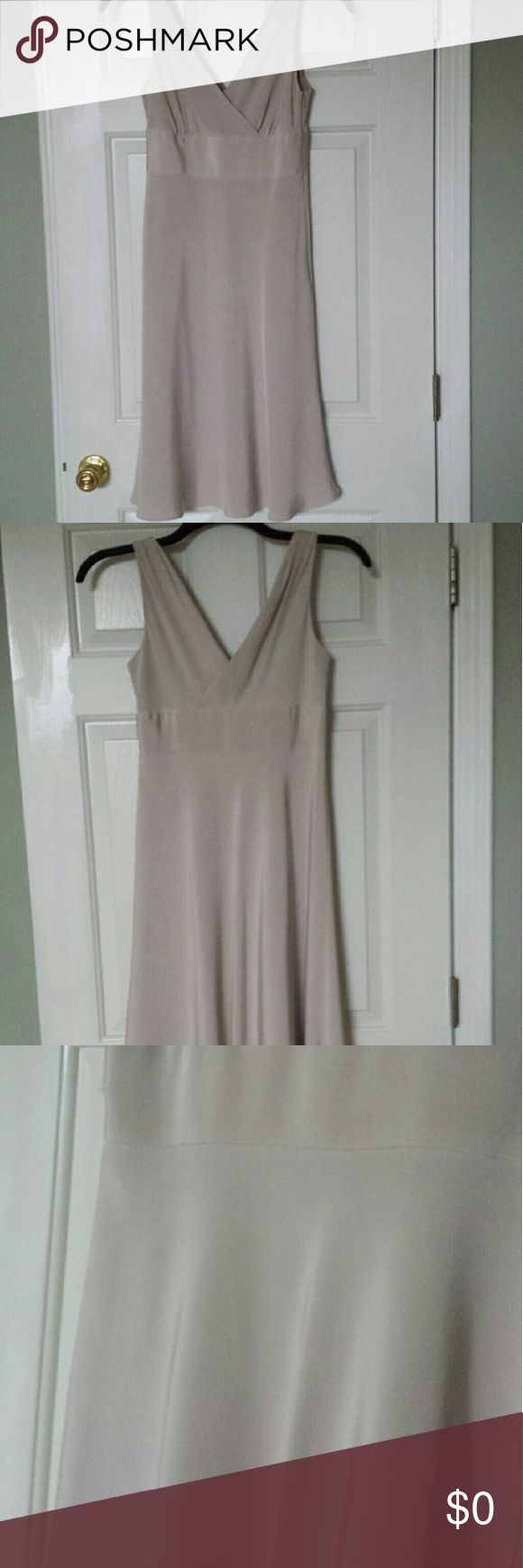 Beautiful Silk JCrew dress Simple yet elegant this dress would be perfect for a night out or a formal event. Gorgeous beige color, best rep in pics 1-2. Double vneck. 100% silk with polyester lining. Beautiful sheen in the light. Side zipper closure. J. Crew Dresses