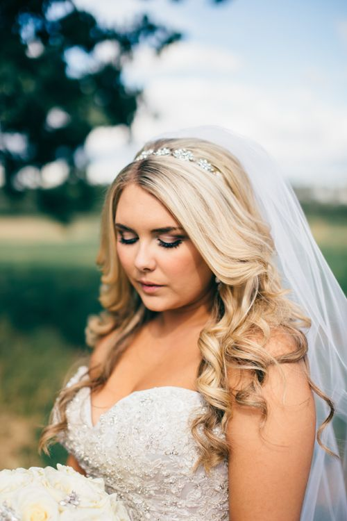 Gorgeous blonde bride with hair down and head piece. Jewel head band. Outdoor wedding photos. http://www.emilyjanephotography.ca http://www.emilyjanephotographyblog.ca