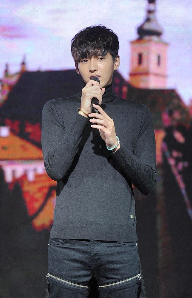 South Korean boy group EXO`s former member Kris Wu Yifan sings at a press conference for the new movie 'Somewhere Only We Know' in Beijing, China, September 11, 2014