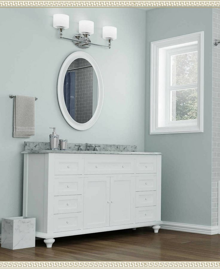 This light blue bathroom <3  I love traditional bathrooms - white vanity, circular mirror… #ad