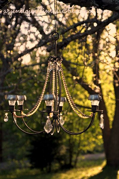 Outdoor chandelier. This is definitely going in the greenhouse. Minus the beads.