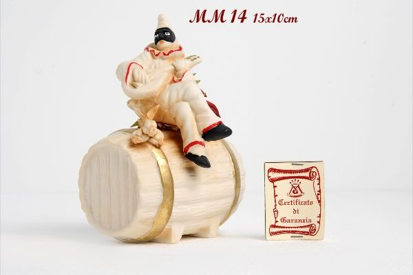 Pulcinella sitting on barrel with spaghetti and mandolin. Note the great attention to detail apparel.