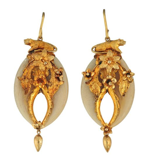 Tiger Claw earrings from the Raj c.1870  Want to do something like this but with shark teeth. I like the way the flowers flow/ fall downwards.