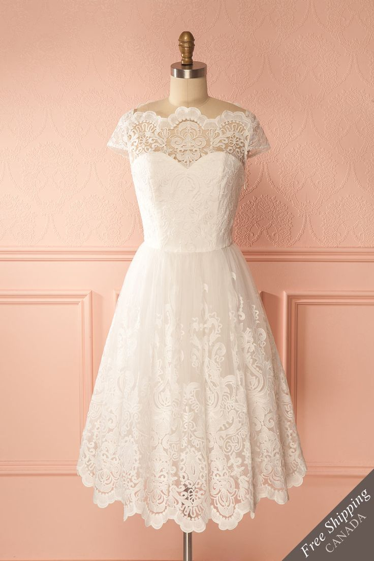 Dotterina Snow #boutique1861 / The Snow Queen will have nothing on you in this majestic dress full of lace and tulle! Its boat neck neckline and embroidered lace gently outline your shoulders and its voluminous skirt falls just under your knees. Pair it with crystal jewelry for a truly magical look!