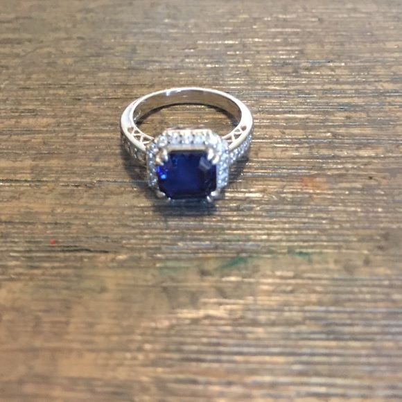 Blue sapphire ring Beautiful lab grown blue sapphire ring set in sterling silver with tiny cubic zirconias surrounding the stone. Size5. Probably bought from QVC or Home Shopping Network Jewelry Rings