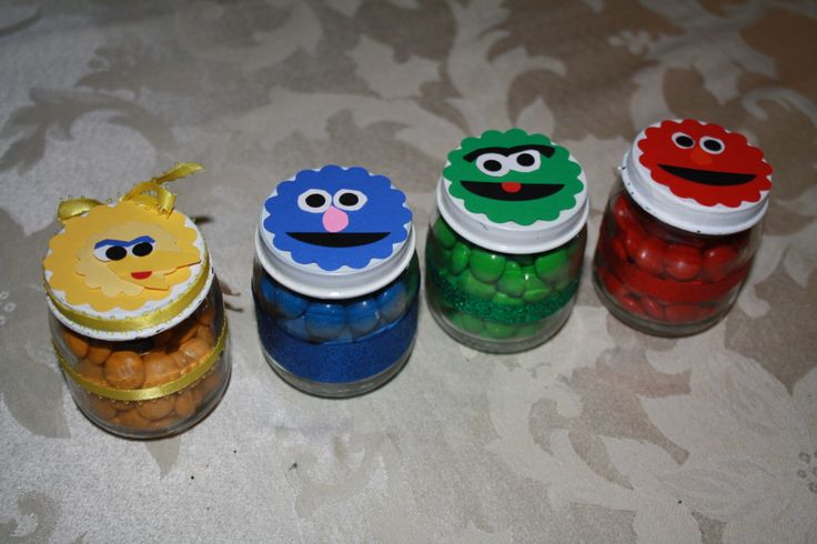 Upcycled Baby Food jars into favors (filled with color coordinated m's), used my creativity with punches to create the Sesame Street characters