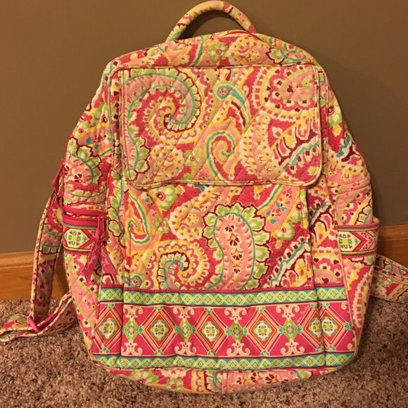 Large pink paisley print Vera Bradley backpack. Retired print, hard to find! Super spacious and cute. Item is authentic. There is no fading, no wear on bottom corners. All straps/zipper ties/snaps are fully intact and functioning properly. Bag has not been washed and proudly comes from a smoke free home. Any questions? Feel free to comment and share!!