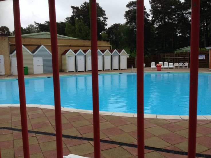 love the vintage style beach huts on the pool side of the outdoor pool @Parkdean Page Sandford Holiday Park #britishholiday #homeoraway