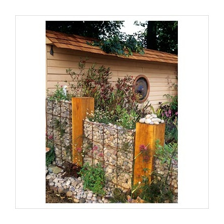 Gabion wall with wooden posts - totally breaks and softens the look.
