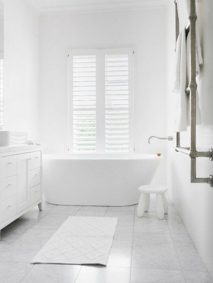 - This will be our bathroom design - white bathroom with concret floor, free standing bath, white shutters and Hampton/Cottage/ style vanity is the exact bathroom look we are going for. Long Sink on top of vanity/ in wall tap mixers and open plan wet room/shower.