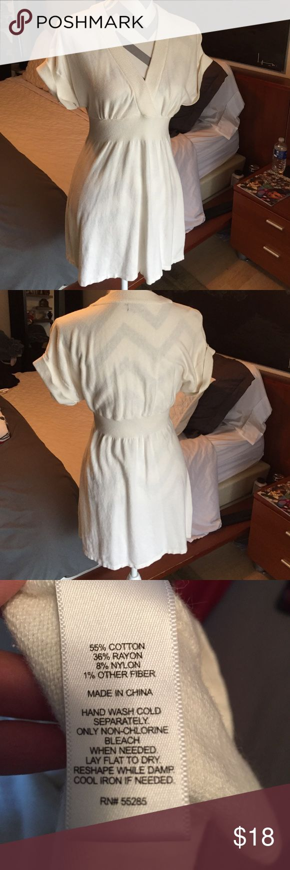 Pretty cream sweater dress Pretty cream sweater dress. V neck with cinched waistband. Very cute with some brown boots. Perfect for cooler weather! Express Dresses