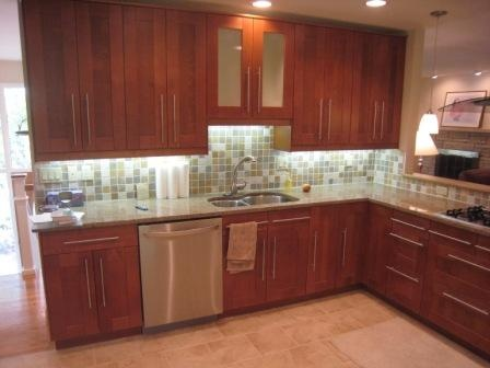 ikea adel medium brown with mid tone countertop and long cabinet handles light floors - Medium Brown Kitchen Cabinets