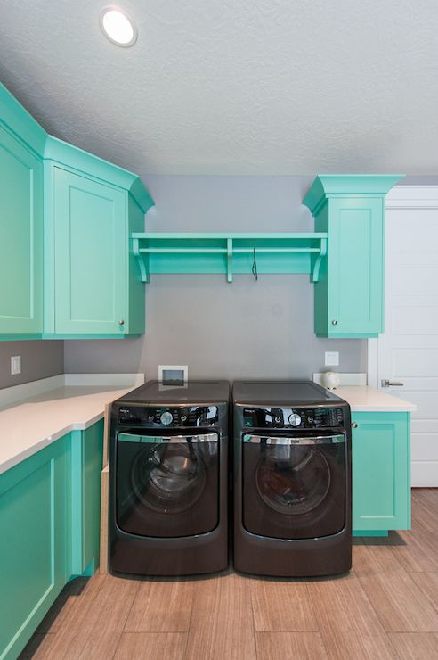Mountain Cabinetry - laundry/mud rooms - teal cabinets, teal laundry room cabinets, laundry room cabinets, white countertops, black washer d...