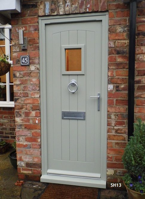 Beautiful grey timber front door, with matching satin chrome door fittings. Looks great against the exposed multi-colour bricks