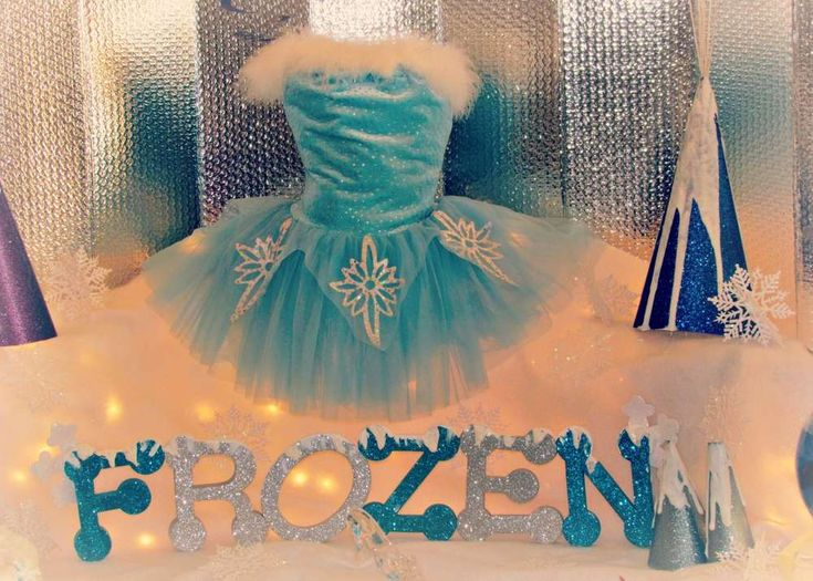 Pretty decorations at a Frozen girl birthday party!  See more party planning ideas at CatchMyParty.com!
