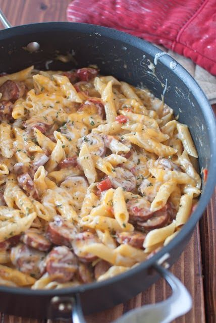 Spicy Sausage Pasta Skillet ~ I made this tonight & it was great! Used hot Italian sausage with the casings removed and regular diced tomatoes b/c I was out of Rotel. The heat in the sausage offset the lack of tomato spice. Very rich, creamy & hearty.