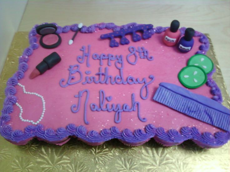 This pretty pink & purple cupcake cake from Kakes by Karen features amazing makeup and beauty accessories such as lipstick, nail polish and a compact.  It was for a little girl's 8th birthday. This birthday cake would be perfect for a Dress Up Party, Diva Party, Makeover Party, Glam Girl Party or Spa Party.